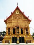 Golden Buddhism church at Ratchaburi Thailand. Golden Buddhism church at temple on sunny day, Ratchaburi, Thailand royalty free stock photos