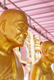 Golden buddhism monk statue Royalty Free Stock Images