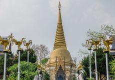 Golden Buddhism pagoda reparation in Wat Pha Phu Gon Temple. UDONTHANI, THAILAND - MARCH 17, 2018 : Golden Buddhism pagoda reparation in Wat Pha Phu Gon Temple Stock Photography