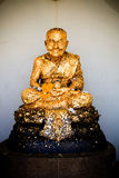 Golden buddhism statue Loung Poh Toe Stock Image