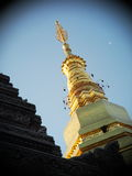 Golden buddhism stupa pagoda north THAILAND Stock Photos