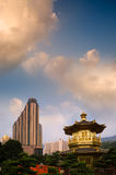 Golden Buddhism tower with modern tall buildings Royalty Free Stock Photos