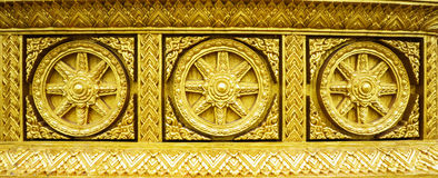 Golden buddhism wheel of the dharma Stock Photos