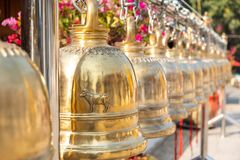 Golden Buddhist bell at Wat Phrathatsrijomtong temple in Chiang Mai, Thailand. The iconic golden Buddhist bell at Wat Phrathatsrijomtong temple in Chiang Mai royalty free stock photography