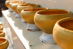 Golden buddhist monk alms bowl for people to donate money Royalty Free Stock Photos