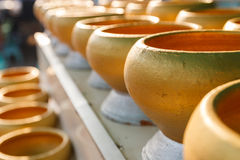 Golden buddhist monk alms bowl for people to donate money Royalty Free Stock Images