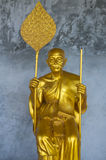 Golden Buddhist Monk Statue Stock Image