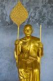 Golden Buddhist Monk Statue Stock Image