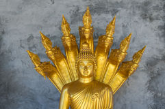 Golden Buddhist Monk Statue Stock Photo