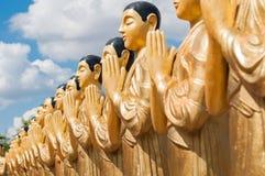Golden buddhist monk statues in Sri Lanka Stock Images