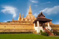 Golden buddhist pagoda of Phra That Luang Temple under blue sky. Vientiane, Laos Royalty Free Stock Photos