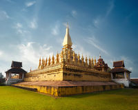 Golden buddhist pagoda of Phra That Luang Temple under blue sky. Vientiane, Laos Stock Photography