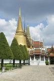 Golden Buddhist Pagoda Spires at Grand Palace Bangkok Thailand Stock Photo