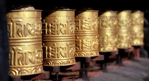 Golden buddhist prayer wheels Royalty Free Stock Image