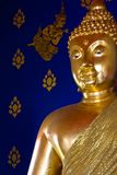 Golden Buddhist's statue Royalty Free Stock Photo