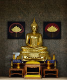 Golden Buddhist statue Royalty Free Stock Photo