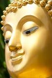 Golden Buddhist statue face Stock Image