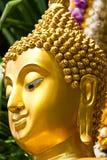 Golden Buddhist statue face Stock Photos