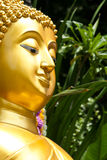 Golden Buddhist statue face Royalty Free Stock Photos