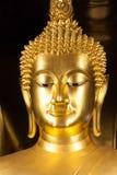 Golden Buddhist statue face Stock Photo