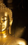 Golden Buddhist statue face Stock Photography