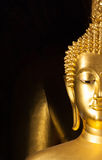 Golden Buddhist statue face Royalty Free Stock Image