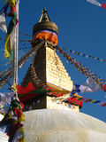 Golden Buddhist stupa. With buddha eyeas anf prayer flags all around Stock Images
