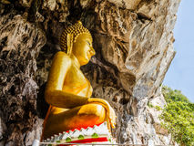 Golden buddhist  in wild cave Stock Photo