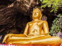 Golden buddhist  in wild cave Stock Photos