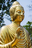 Golden buddhistic figurine Stock Images