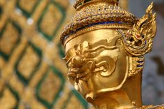 Golden Buddhistic statue in a temle Royalty Free Stock Image