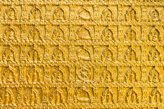 Golden buddhistsm wall pattern in a temple Ubon Thailand Stock Images