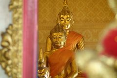 Golden of buddish state in the art style ,Wat Krathum Suea Pla t. Emple Stock Photography