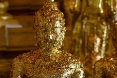 Golden of buddish state in the art style ,Wat Krathum Suea Pla t. Emple Royalty Free Stock Images