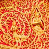 Golden budha on red background Royalty Free Stock Photo