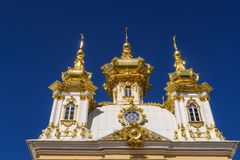 Golden Building at Peterhof in Front of Blue Sky royalty free stock photography