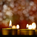 Golden burning candles Royalty Free Stock Photos