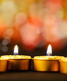 Golden burning candles Stock Image