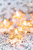 Golden burning candles bokeh blured background. Stock Photography