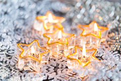 Golden burning candles bokeh blured background. Stock Images