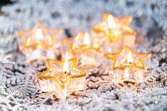 Golden burning candles bokeh blured background. Royalty Free Stock Photo