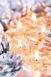 Golden burning candles bokeh blured background. Stock Image