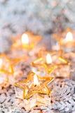 Golden burning candles bokeh blured background. Royalty Free Stock Photos