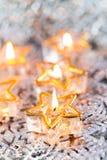 Golden burning candles bokeh blured background. Stock Photos