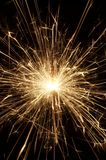 Wunderkerze. Golden burning sparkler in action Royalty Free Stock Photos