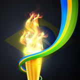 Golden Burning Torch for Sports concept. Stock Image