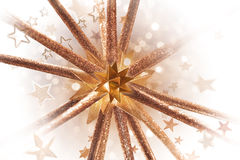 Golden Bursting Star Form. Golden christmas star form, bursting with decorative glitter and various star shapes Stock Images