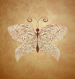 Golden butterfly on dark brown background Royalty Free Stock Images