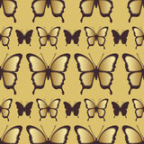 Golden butterfly seamless pattern. Luxury design, expensive jewelry. Exotic patterned Insect, repeating decorative element. Golden wings a yellow background Royalty Free Stock Photo