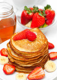 Golden buttermilk pancakes. With fruits and honey Stock Photos